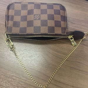 Louis Vuitton Mini pouchette in damier ebene